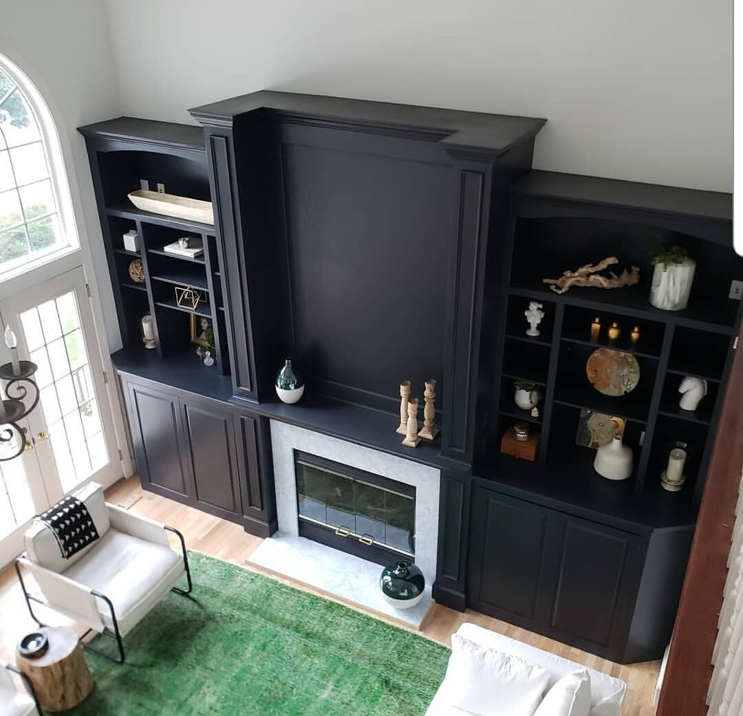 Living room cabinets refreshed with black paint